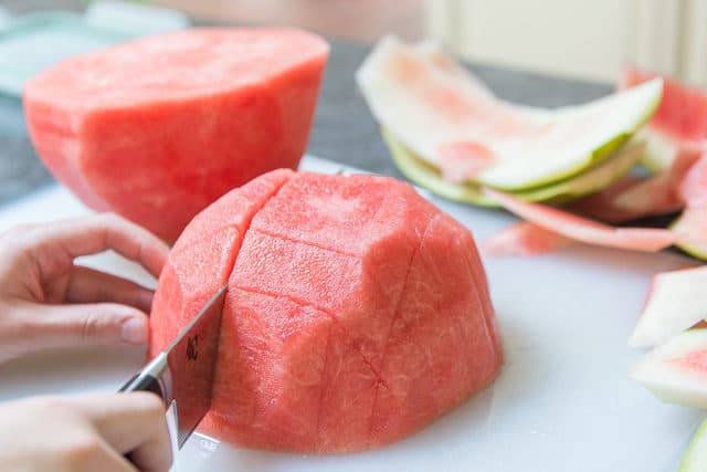 How to Cut Watermelon Sticks - Straight Down on Cutting Board