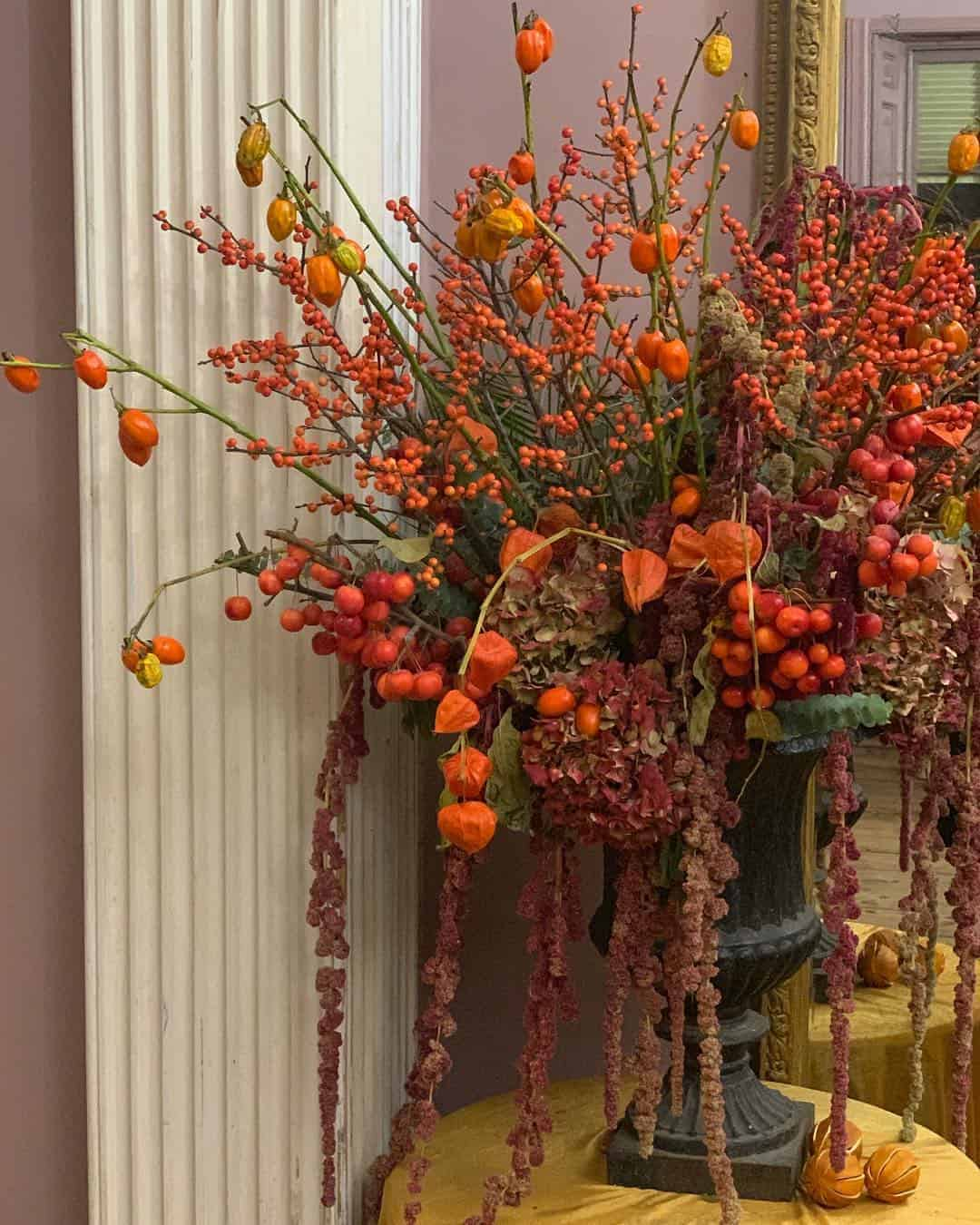 love these bright orange and red autumn flowers with chinese lantern and red berries by Kate Langdale click through for loads more creative autumn flower ideas you