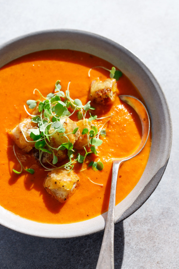 The Best Tomato Soup using canned tomatoes, topped with cheesy croutons!